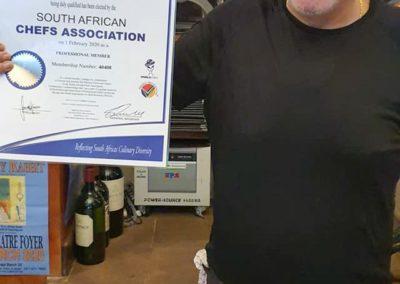 Romano Gorrini holding his SA Chefs Association certificate
